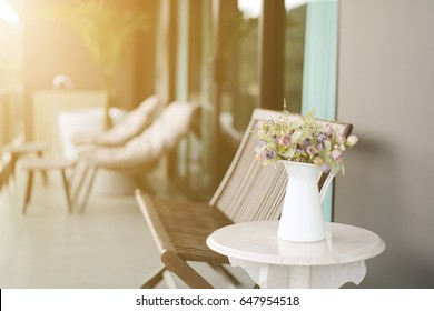 Condominium of balcony with small table chair and rose flowers. Soft light, Vintage image