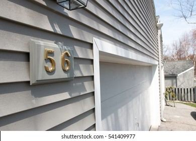 Condominium garage door siding