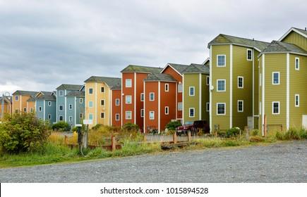 condominium Homer Spit Alaska on a cloudy day. Homer is a small city on Kachemak Bay, on Alaska's Kenai Peninsula. Homer Spit is a long strip of land.