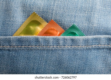 Condoms in the blue jeans pocket