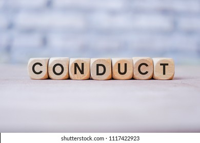 Conduct word written on wood block