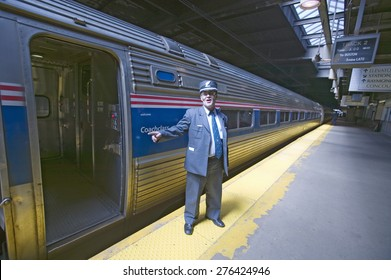 """""""Conductor at Amtrak train platform announces """"""""All Aboard"""""""" at East Coast train station on the way to New York City, New York, Manhattan, New York"""""""