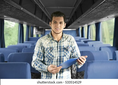 Conductor inside bus with clipboard