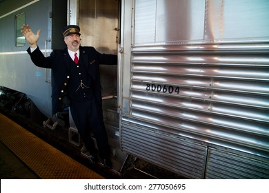"""Conductor says """"All Aboard"""""""" on Pearl Harbor Day Troop train reenactment from Los Angeles Union Station to San Diego"""