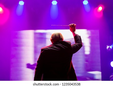 Conductor with a stick on live performance