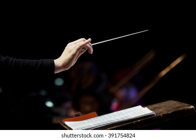 conductor's hand on a black background
