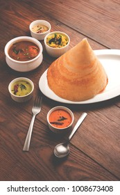 Cone Masala dosa is a South Indian meal served with sambhar and coconut chutney. Selective focus