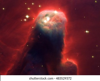 The Cone Nebula (in NGC 2264) The upper 2.5 light-years of the Cone, a height that equals 23 million roundtrips to the Moon,Elements of this image are furnished by NASA.