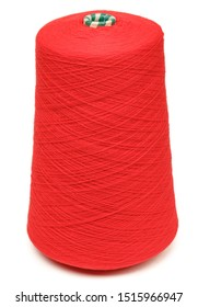 Cone of red color synthetic or wool threads isolated on white background. Spool of yarn for weaving or knitting used in textile manufacturing