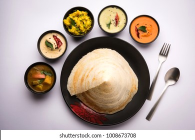 Cone shape Masala dosa is a South Indian meal served with sambhar and coconut chutney. Selective focus