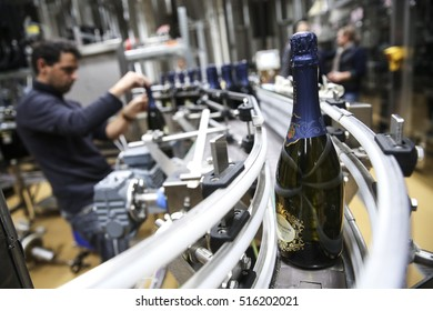 CONEGLIANO, ITALY - 6 NOVEMBER 2015: Bottles of Italian Prosecco wine moving along a conveyor belt at an Italian winery.