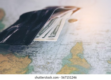 conept image of dollar in the wallet  on the world map