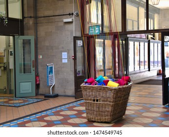 Cones of coloured yarn comming from a basket in the Byram Arcade Huddersfield Yorkshire England 09/08/2019 by Roy Hinchliffe