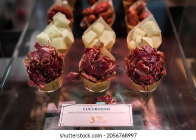 Cones or cucurucho pintxos or tapas with Spanish serrano iberico ham carvings, sausage and cheese pieces at a local butcher shop in Pamplona Spain