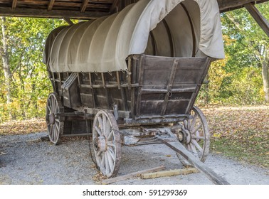 A Conestoga wagon sits under a protective shed in Ontario Canada.