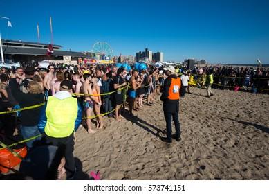 CONEY ISLAND, BROOKLYN, NY/USA – JANUARY 1, 2017 Revelers celebrate the new year at the annual Coney Island Polar Bear Club New Year's Day swim.