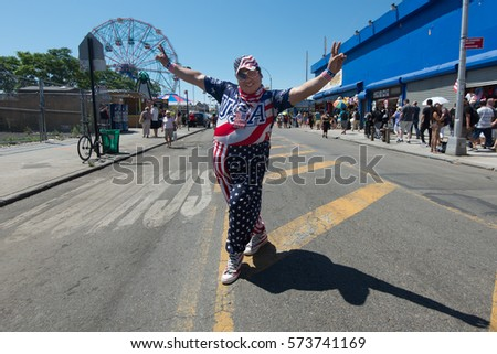 CONEY ISLAND, BROOKLYN, NY/USA – JULY 4, 2016 A patriotic reveler celebrates the Fourth of July holiday in Coney Island.
