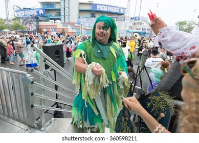 CONEY ISLAND, BROOKLYN, NY/USA - JUNE 20, 2015: A participant bribes judges in the annual Mermaid Parade.