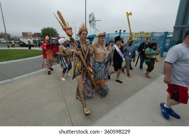 CONEY ISLAND, BROOKLYN, NY/USA - JUNE 20, 2015: Queen Mermaid & King Neptune Julie Atlas Muz and Mat Fraser march twoards the ocean after the annual Mermaid Parade.