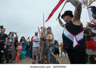 CONEY ISLAND, BROOKLYN, NY/USA - JUNE 20, 2015: Queen Mermaid & King Neptune Julie Atlas Muz and Mat Fraser cut a ribbon as they march towards the ocean after the annual Mermaid Parade.