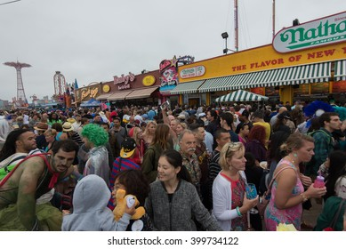 CONEY ISLAND, BROOKLYN, NY/USA - JUNE 20, 2015: A crowd celebrates on the boardwalk after the annual Mermaid Parade.