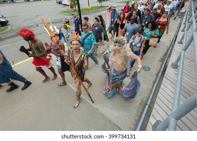 CONEY ISLAND, BROOKLYN, NY/USA - JUNE 20, 2015: Queen Mermaid & King Neptune Julie Atlas Muz and Mat Fraser march towards the ocean after the annual Mermaid Parade.