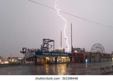 CONEY ISLAND, BROOKLYN, NY/USA -  OCTOBER 9, 2015: Lightning strikes the Coney Island amusement district during an October thunderstorm.