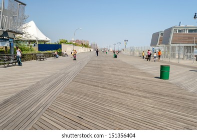 CONEY ISLAND - MAY 30: Coney Island Boardwalk seen on May 30, 2013. The 2.51 mile seaside boardwalk has drawn visitors since 1923, still hosting famous amusement parks as long as the New York Aquarium