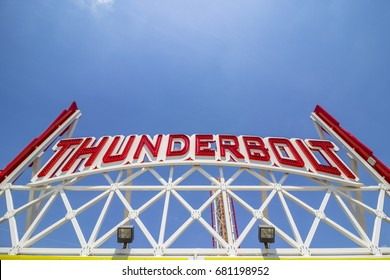 Coney Island, New York, United States - May 19, 2017: Thunderbolt game sign next to entrance of Luna Park.