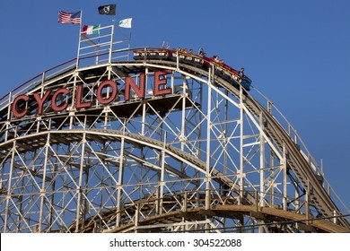 Coney Island, New York, USA - July 11, 2015: People riding the famous Cyclone wooden roller coaster on the first or main drop in Coney Island, New York on July 11, 2015