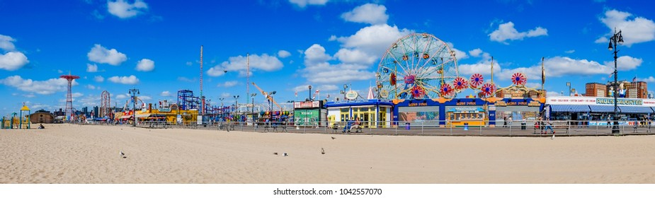 CONEY ISLAND, USA - OCT 3, 2017 People visit famous old promenade at Coney Island, the amusement beach zone of New York.