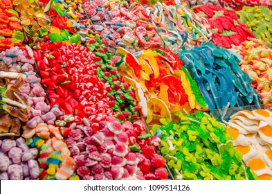Confectionery on the market store shelves. Variety of colored sweets