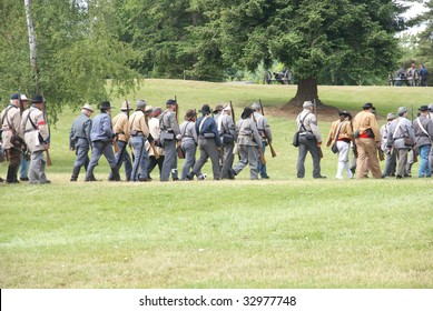 Confederate troops marching in column formation,   Civil War Battle Re-enactment,  Port Gamble, WA