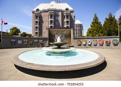 Confederation Fountain in Victoria, Canada is a large public park with fountain and the coat of arms of each province, in the center of Victoria frequently visited by locals and tourists.