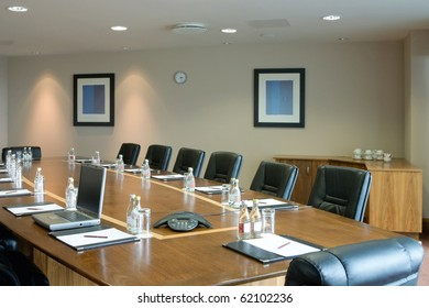 conference hall Interior with table, raw of chairs and blocknotes