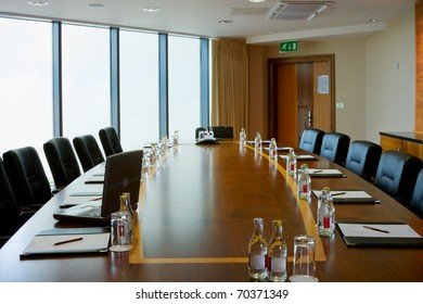 conference hall Interior with table, raw of chairs and block-notes