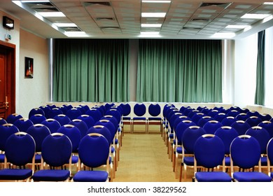 Conference hall with rows of blue chair