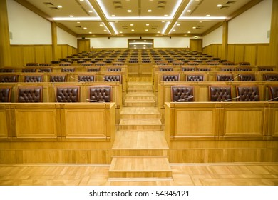 Conference halls with magnificent leather armchairs and wooden tables with microphones, Wide angle