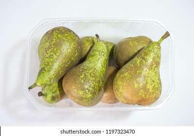 Conference pears on their plastic package. Uncovered