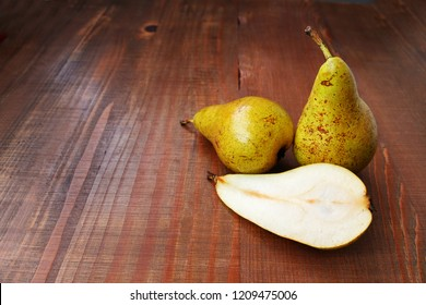 Conference pears on wooden table with copy space