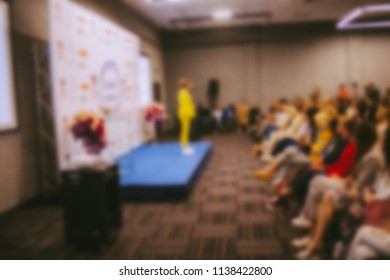 conference. people in the conference room. speech speaker in front of the audience. the audience in the conference room. blurred image / blurred photo. Vintage toning