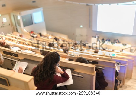Conference and Presentation. Audience at the conference hall. Business and Entrepreneurship. Faculty lecture and workshop. Audience at the lecture hall. Academic education. Student making notes.