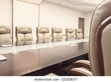 Conference room before meeting, beige toning