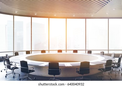 Conference room interior with a round table, black office chairs near it and a panoramic window. 3d rendering, toned image