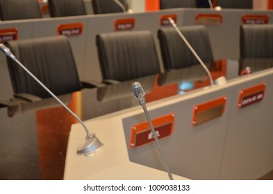 Conference room interior.Modern Design White Dining Room Interior Architecture.Close up of coffee cup, pens and paper sheet on wooden conference table.