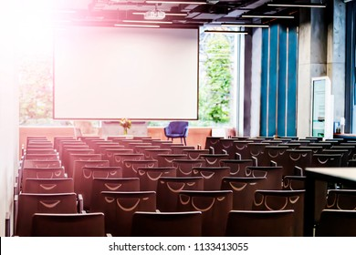 Conference room in modern business center, audience in college or assembly hall in the church. concept: business, education, lecture, congressional elections. Glow effect, shallow depth of field.