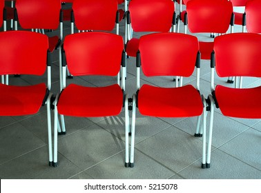 Conference room with red seats, grey floor