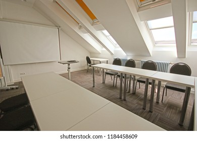 Conference room in a suggestive loft, all minimalist black and white style with nice relaxing lighting