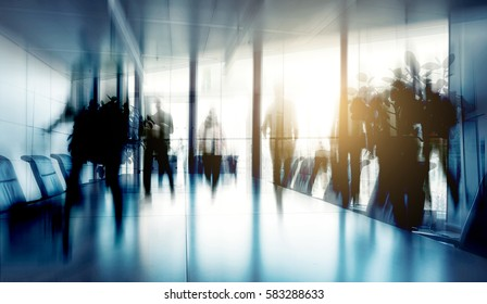 Conference table and chairs with Blurred business people