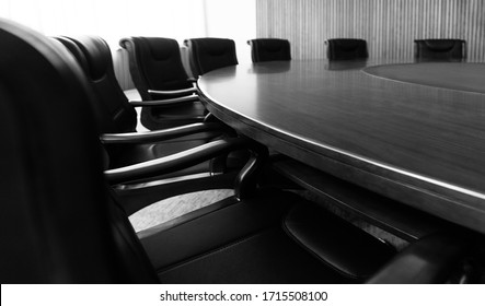 Conference table and chairs in modern meeting room.
